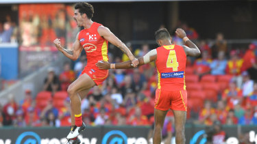 Golden moment: Alex Sexton (left) fired up in the fourth quarter to help the Suns take control of the game against the Dockers.