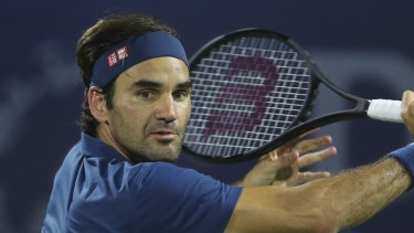 Moving on: Roger Federer needed three sets once more to reach the Dubai last eight.