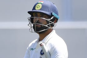 Not a one man team: Indian captain Virat Kohli was out cheaply twice in Adelaide... but India still won.