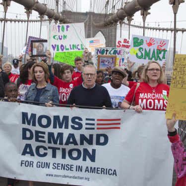Mothers (and a father) opposing guns walk across the Brooklyn Bridge.