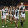 Dejected Collingwood players after their Round 18 AFL loss to GWS.