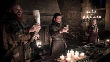 Earlier in the same scene: a toast, and no sign of Emilia Clarke's coffee cup.