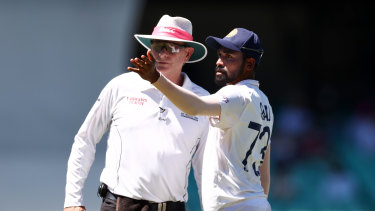 Mohammed Siraj speaks to umpire Paul Reiffel on Sunday.