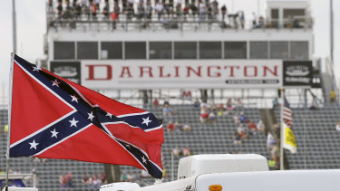 A Confederate flag flies in the infield before a NASCAR Xfinity auto race at Darlington Raceway in South Carolina in 2015.