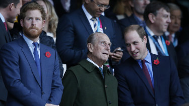 Prince Harry, Prince Philip and Prince William at a rugby match in 2015.