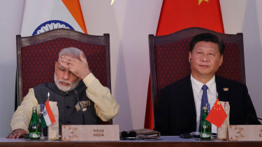 Indian Prime Minister Narendra Modi, left, and Chinese President Xi Jinping attend the BRICS summit in Goa, India, in 2016.