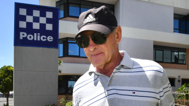 Chris Dawson is seen leaving the Maroochydore District Police Headquarters on Boxing Day.