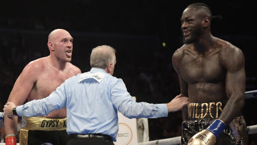 Tyson Fury taunts Deontay Wilder.