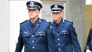 Superintendent Peter Ward (right) and Assistant Commissioner Michael Grainger arrive at the Coroner's Court on Monday.