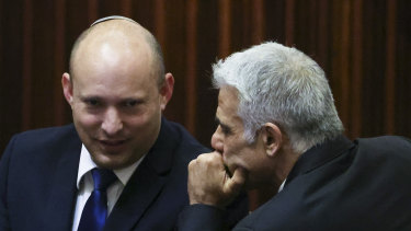 The new PMs: Yamina party leader Naftali Bennett, left, smiles as he speaks to Yesh Atid party leader Yair Lapid.