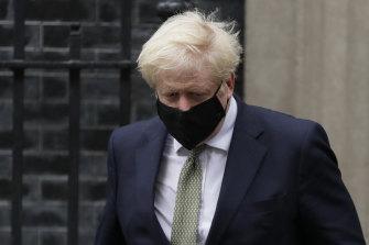 British Prime Minister Boris Johnson leaves Downing Street to address Parliament on Monday.