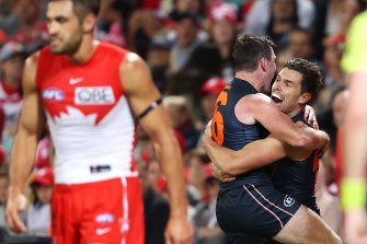 Brent Daniels and Josh Kelly celebrate after the Giants' late goal at the SCG.