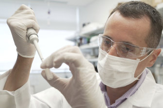 Researcher Nicolas Barthelemy works on a p-tau217 test for Alzheimer's disease.