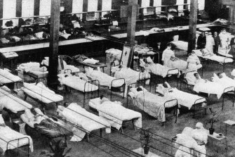 Hospital beds in the Great Hall of the Exhibition Building during the Spanish flu pandemic.
