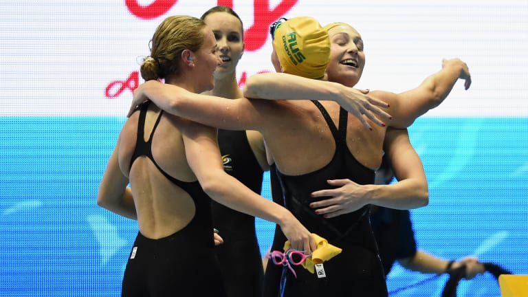 Camaraderie: Ariarne Titmus, Emma McKeon, Madeline Groves and Mikkayla Sheridan embrace after earning bragging rights over the Americans.