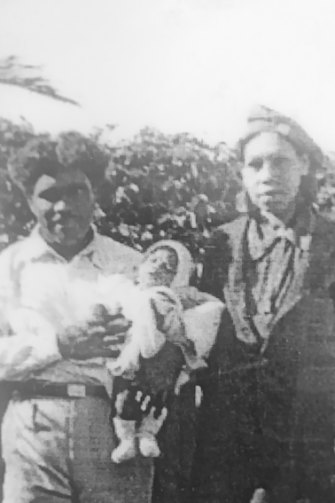 Archie Roach's father, Archie Roach snr, and mother, Nellie Austin, with their first baby, Johnny, in 1940.