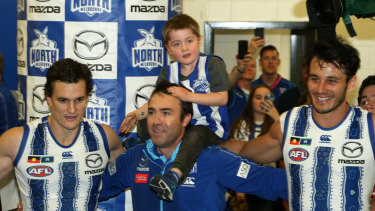 Once more with feeling: Brad Scott joins the Kangaroos to sing the team song for the last time.