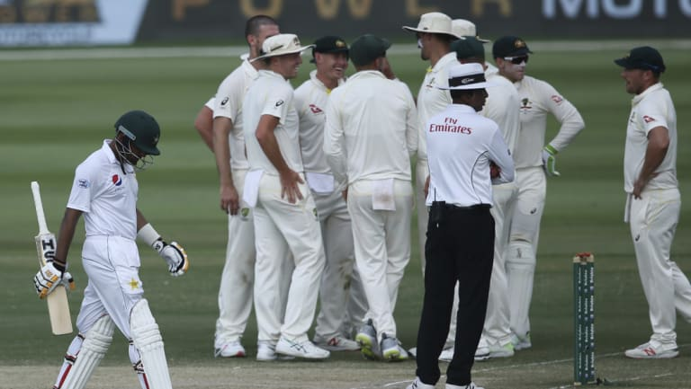 Near miss: Pakistan's Babar Azam, left, walks off after being dismissed for 99.