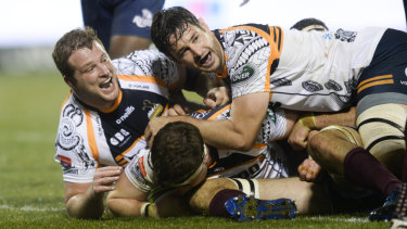 Pathway: The Brumbies celebrate a try in their big win over the Reds.