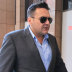 George Alex has been charged over the $17.5 million tax fraud. His son Arthur (inset) has also been charged.
