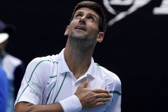 Divine inspiration: Serbia's Novak Djokovic reacts after progressing to the Australian Open quarter-finals.