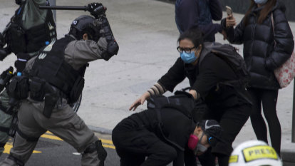 Hong Kong rally cut short as protesters and police clash