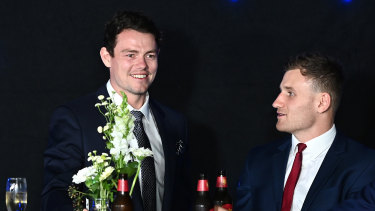 Soaking up the atmosphere: Lachie Neale (left) speaks to Rory Laird of the Crows during the 2020 Brownlow Medal count in Brisbane.