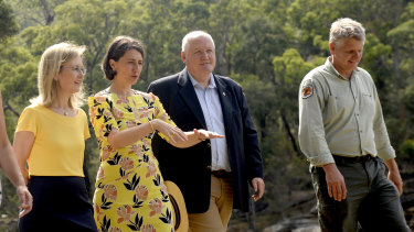 NSW Minister for the Environment Gabriel Upton, NSW Premier Gladys Berejiklian, Lee Evans MP and Glenn Meade, Operations Manager of the National Park and Wildlife Service at the Royal National Park, south of Sydney on Monday.
