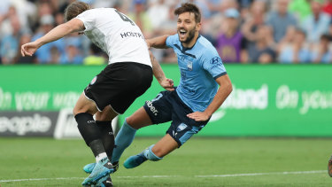 Penalised: Sydney FC's Milos Ninkovic is brought down in the box by City's Harrison Delbridge.