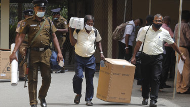 Sri Lankan polling officers dispatch election material to polling centers ahead of the parliamentary elections in Colombo, Sri Lanka.