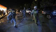 Security forces rush to respond to a Taliban attack on the campus of the American University in the Afghan capital Kabul three weeks after Timothy Weeks was kidnapped.