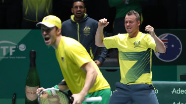 Lleyton Hewitt, right, celebrates Australia's doubles win over Colombia.
