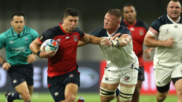 Ben Youngs of England holds off Hanco Germishuys of USA during a 2019 Rugby World Cup match.