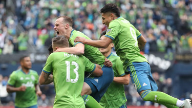 Seattle celebrate Kelvin Leerdam's goal during the MLS Cup final.