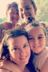 Ms Sliwa (front) with mother Karen, sister Alison and daughter Ava last year.