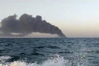 Smoke rises from Iran's navy support ship Kharg before it sank in the Gulf of Oman.