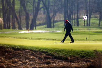 Donald Trump plays golf at his course in Virginia.