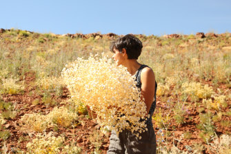 Katie West collecting materials as  Nyinyart Yinda artist-in-residence at Juluwarlu Aboriginal Corporation in Roebourne, WA.