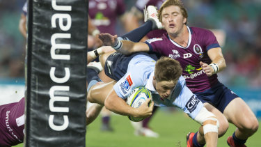 Sealing the deal: Alex Newsome dives over for the Waratahs at the SCG.