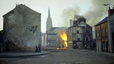 A building burns in the Bogside district of Londonderry, Northern Ireland, in the aftermath of Bloody Sunday in February 1972.