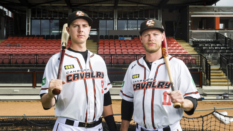 Canberra Cavalry players Robbie Perkins and Kyle Perkins in front of the redeveloped grandstand.