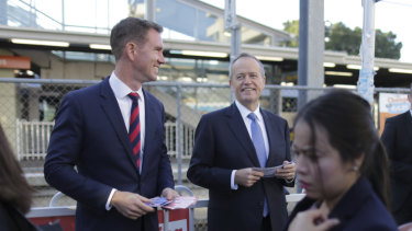Labor candidate for Reid Sam Crosby and Opposition Leader Bill Shorten campaigning at Rhodes train station.