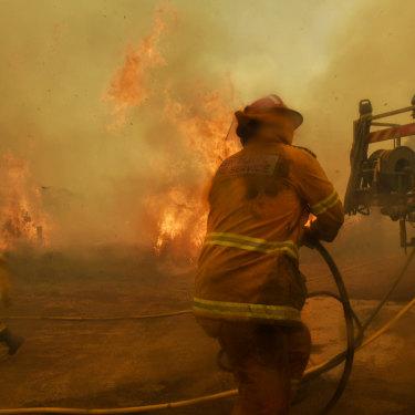 Rural Fire Service volunteer firefighters battle spot fires at Hillville on November 13.