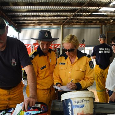 RFS Rainbow Flat firefighters replenish their medical kit at a temporary shed on a RFS member's property after the original shed was destroyed on November 8, 2019.