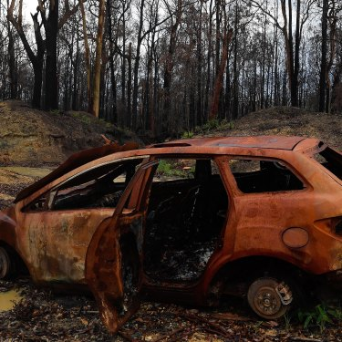 A burnt car that had been previously abandoned sits in Crowdy Bay National Park, which was hit by the Hillville fire.