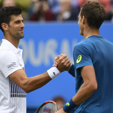 Novak Djokovic of Serbia shakes hands with Vasek Pospisil of Canada after a match in England. The duo are united in their belief in a players' union.