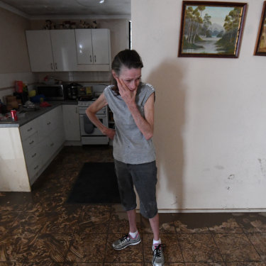 Sue Pollard becomes emotional as she takes in the damage to her Townsville home.