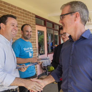 Stuart Ayres shaking hands with Michael Daley in South Penrith.