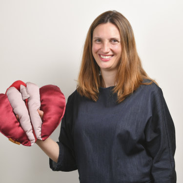 Occupational therapist Anita Brown-Major and her satin vulva puppet, which she uses in teaching.