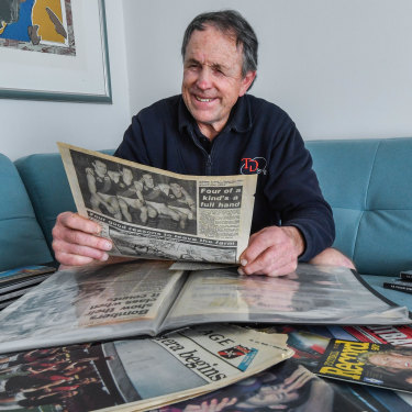 Terry Daniher with the clippings from that famous day he played with his brothers for Essendon in 1990.